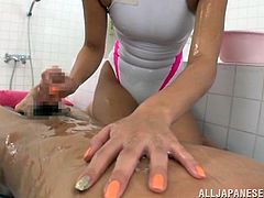 Kinky Japanese chick Hikari wearing a swimsuit oils her man's body and gives him a hot massage. Then she subs his dick against her cocohie and shows her handjob skills.