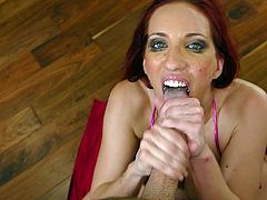 Curvaceous redhead chick in bikini and high heels sits down on the floor and fingers her vagina. After that she gives deepthroat blowjob and licks balls.