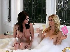 Emily Addison and her sexy friend take a bubble bath together and, of course, have a little lesbian lovin, too. So if you like your sex girl-on-girl and sensual, have at it.