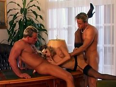 Hot Victoria Swinger drops to her knees and blows two dicks with pleasure. After that she gets fucked in her pussy and ass at the same time.