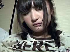 Kaede Koriuchi has her tits pinched by a creepy old man in his apartment and he pulls her panties down to reveal her young, shaved pussy. He sticks a candy in his mouth and sucks on it then inserts the candy in her vagina.