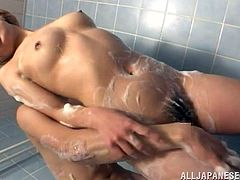 Playful Japanese girl takes bubble bath. After that she gets her boobs and hairy pussy fondled by some dude. Then she also gives a blowjob and gets a facial.