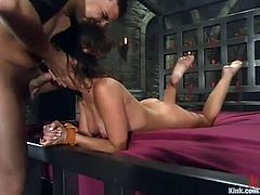 Beautiful brunette Penny Flame gets chained by Tony T in a vault. Then the dude mouth-fucks Penny and they have some wild banging in side-by-side position.