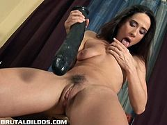 If you love girls playing with huge dildo, well this one is for you. She spreads her legs and sticks it deep up her tight shaved pussy like a pro!