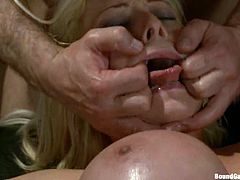 Horny blonde chick gets tied up and face fucked. After that she lies down on a sofa and gets fucked rough in both holes.