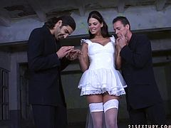 Spoiled brunette babe in wedding dress looks too good to be true! Her face has that unique combination of comeliness and sexuality! Naughty bride is quite a talented cock sucker! She can please two men at once! Check out this hot threesome sex scene and I'm kinda sure you will appreciate her talent!