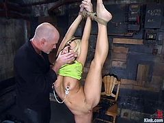 This booty and busty blondie gets tied up and ball gagged. Then Mark takes all the fetish tools off her body and goes for her wet cave!