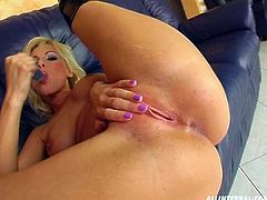 Ardent blondie is rather pretty. This nympho with natural tits desires to reach orgasm on her own. Spoiled girlie with smooth ass strips and takes a dildo to fuck her wet pussy for lots of delight right on the couch.