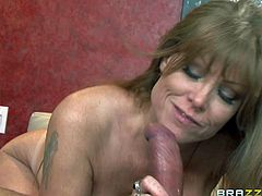Darla Crane is a sinfully sexy cougar with bubble ass and huge tits. Man with camera in hand has a nice time fucking this hot mature babe. Busty MILF sucks his dick and then he drills her wet pussy.