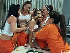 In this video you will see what happen in women's prisons. Some cute girl gets her vagina and ass stuffed with huge dildos by her cellmates.