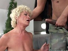 Freaky granny Effie examines new vibrator. Then she takes off her skirt bending over the couch. She gets her beef curtains stretched wide. Later she is mouth fucked by horny black stud.