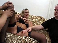 Don't pass by this impressively hot Pornstar MMF sex clip. Kinky blond haired chick in black stockings and lingerie spreads legs wide. She gets her wet pussy rubbed and provides black and white men with stout blowjobs for sperm in return.