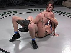 Two slutty fucking bitches wrestle naked in the ring and the one who loses gets fucked by the winner, check it out right here!