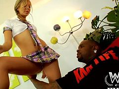 Chastity is a sexy tight bitch in tiny schoolgirl uniform,She seduced these two horny black dude with hot striptease and let them play with her tight shaved pussy before giving them hot blowjob.Enjoy!