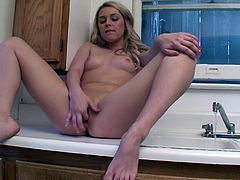 Amateur solo sex scene takes place in the kitchen where the slut gets naked and fondles her pink pussy for the camera, check it out!