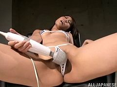 Slim Japanese chick is having a good time alone. She strokes her hot pussy ardently and then rubs it with her favourite dildo.