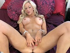 Get ready to be startled by this blonde's beauty and sensational body in this solo video where rubs on her wet pussy and fingers it as well.