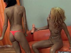 Kinky slender brunette lesbian goes wild. She makes horny blondie suck a dildo like a cock. Then curly blondie spreads legs wide, opens her pussy and gets it fisted right away on the couch.