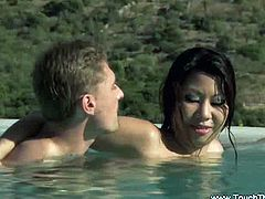 This Asian babe slides her naked body all over a guy's naked body, making him very horny. They, they get in the pool and fuck.