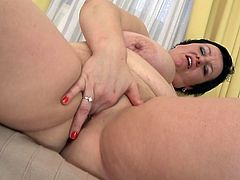 Tima likes it black, she naked and wears only her black boobs. The brunette mature has a pair of big naughty breasts and she knows that those boobs are making us horny. Tima puts her dildo between her breasts and rubs it like it's a real cock. such a sensual and busty mature lady deserves a good hard fuck!