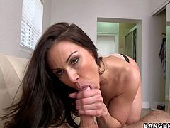 Heavy chested and dark haired Kendra Lust enjoys in teasing her man with a nice slutty blowjob session as she gets on her knees on the bed in bedroom