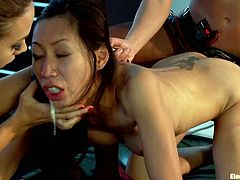 Tia Ling is getting double teamed in a lesbian femdom video by two girls with strapons who also double penetrate her!