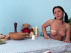 This cute teen is enjoying breakfast. She is having some nice delicious crepes. Her man gets the bright idea to spray it on her tits and pussy and then he licks it off of her body. She lays back on the table and she sucks his dick.