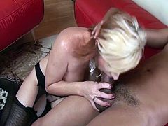 Nasty mature lady with big tits opens her legs wide and plays with her pussy on camera. When her black lover appears she doesn't think twice before starting to suck his cock and opening her legs for a good fuck.