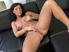 Mature redhead slut fingers her pussy and tastes her fingers