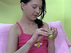 Brunette teen plays with lollipop