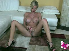 Ana Mancini shows off her hot shemale body in a solo video. She has perfect toes, huge tits and a hard cock.