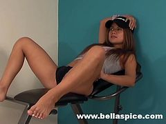 Young Bella Spice looks amazing while gently getting nude and teasing with her forms