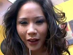 Exotic black haired asian milf Jessica Bangkok with big juicy hooters and hot body in sexy black blouse gets pretty face fucked rough and gags big stiff cannon in close up.