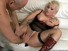 Obese blond mom in raunchy black lingerie and stockings with vulgar tattoos all over her body gets her hairy pussy fingered by rapacious daddy before she stands in doggy pose to get fucked up with dildo machine.