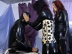 Two sexy femdoms in latex having fun punishing their horny slave,They make him drink piss and had fun in teasing this poor slave,Watch how they enjoy playing with their slave.