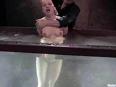 Lewd chick Katja Kassin gets bound in some foul basement. Then some guy fucks the bitch's cunt with a toy and drowns her in a glass box.