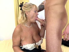 A big hard cock is enough to make Regina drool. She loves younger men and can't have enough! Look at her how she licks this guys hard dick, sucks it and then grabs her boobs to squeeze it between them, before continuing the oral sex. Regina knows how to use her lips and boobs, but how good is she with her pussy?