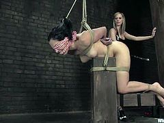 January Seraph gets bound by Maitresse Madeline. Madeline toys Seraph's coochie and then attaches wires to it.