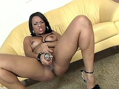 Watch this ebony babe penetrating her sweet black pussy with a big dildo in this solo video where you'll get a serious boner.