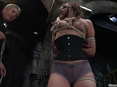 Sexy brown-haired chick Amber Rayne allows some guy to put her into chains in a basement. The dude torments the girl and fucks her vag with a dildo and then drowns her in a box filled with water.