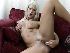 Sensual blonde poses her fine pussy while being deep stimulated in her naughty solo