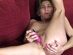 A fucking old woman gets naked and performs a solo scene where she fucking inserts a hard toy in her pussy, check it out!