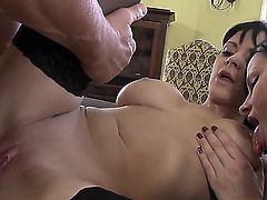 Black haired lusty nymphos Abbie Cat and Natasha Brill with big tits and juicy bodies in stockings only get fucked by turned on mature stud and give him memorable footjob.