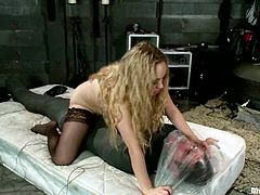 The extreme bondage is followed by tough torture with clothespins and spanking, with also ball torture going on by Aiden Starr.