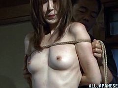 Slim Japanese hottie Reiko Sawamura is playing dirty games with a few men. The guys tie the hussy up and then finger her coochie and stuff it with toys.