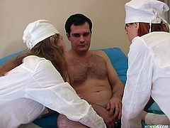 Maria and Tatiana look after their sick patient in a hot cfnm action. These Russian nurses pull down his blanket, suck his cock, and tickle his balls gently. They suck him gently and share his cock, will the nurses going to share his cum?