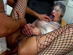 Slutty babe in fishnet gets nailed during hardcore anal BDSM porn scene