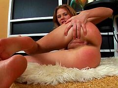 Blonde solo girl fingering her plump, perfectly shaved pussy