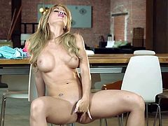 Nasty and pretty arousing blonde lady Angela Sommers enjoys in showing her sexy curved body and playing with her sex toys on the chair in the classroom in front of the camera