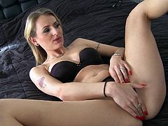 Blonde mom Natasha is crazy for black dudes with big hard cocks. Here she just got one and she's about to have some action with him. Natasha rubs her shaved pussy while he sucks her nipples and then receives a mean pussy lick. She's ready for his dick now and kneels to fill her mouth with it.